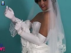 It�s impossible not to wonder what she is wearing under her gorgeous wedding dress